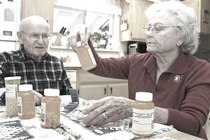 Senior couple on Medicaid looking at their prescription bottles