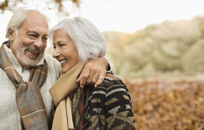 Happy retired couple in autumn setting