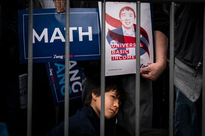 Isaac Tom, 10, listens as Democratic presidential candidate Andrew Yang speaks during a rally in Washington Square Park, May 14, 2019 in New York City.