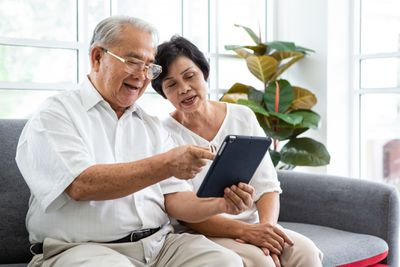 Senior Couple Looking at Tablet Device