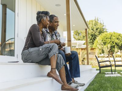Mature couple drinking coffee on porch