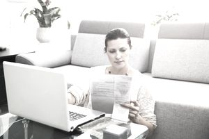 woman filing taxes while sitting on the floor