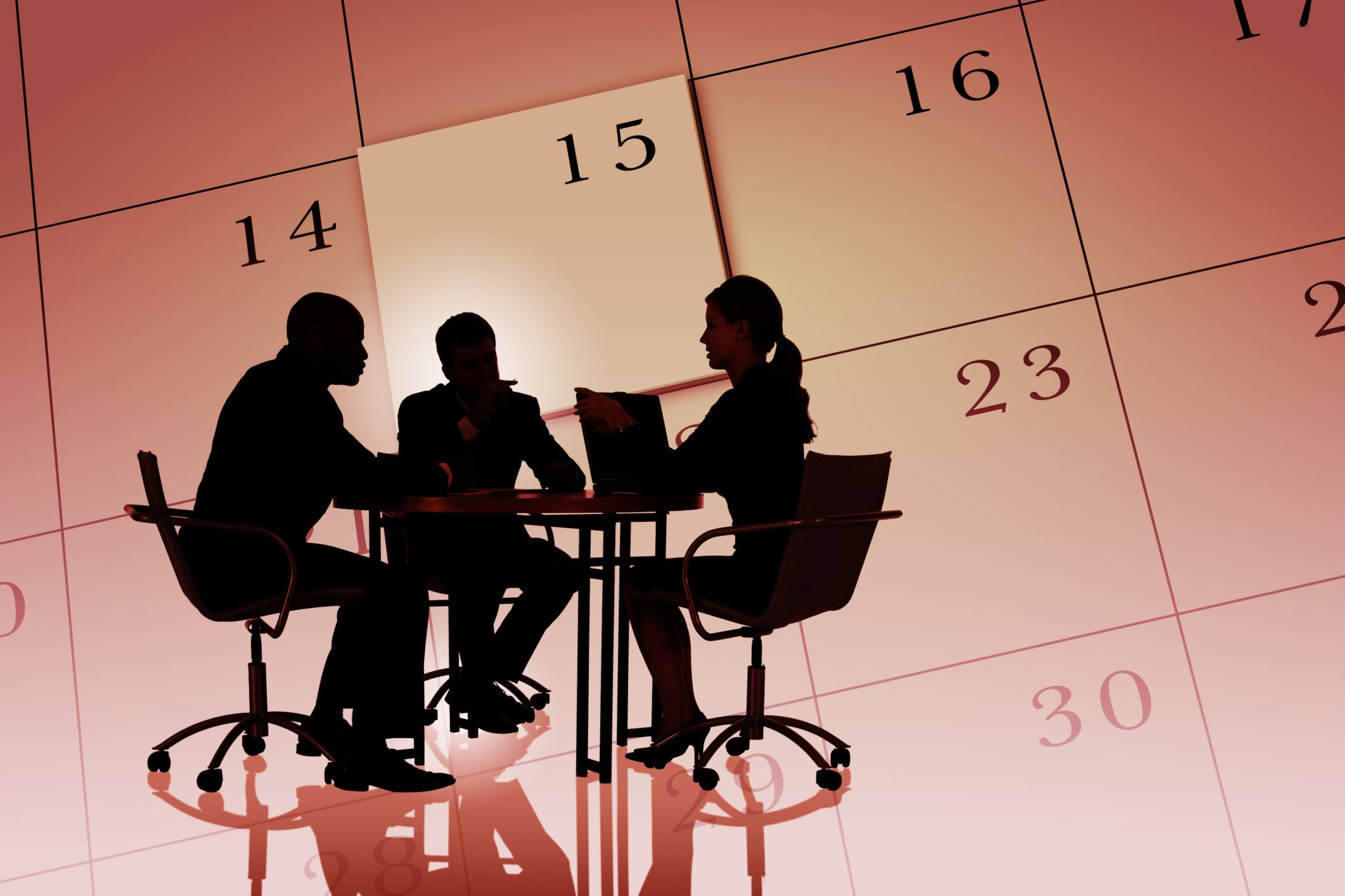 Giant calendar with a conference table.