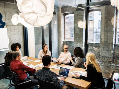 A group of people in a business meeting