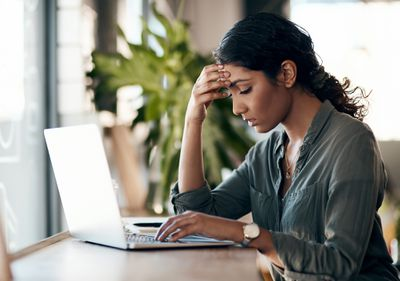 Stressed-out person looking at computer