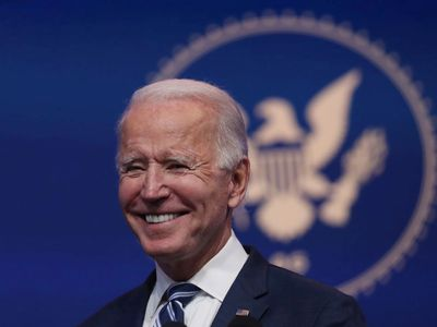 President-elect Joe Biden in front of a blue background with an eagle seal