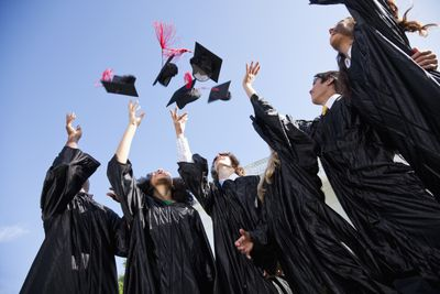 Graduating class tossing their caps in the air
