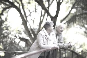 Senior couple standing together on a picturesque bridge