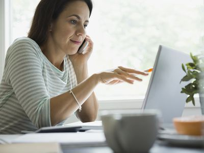A woman is discussing business over the phone