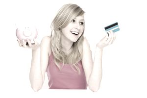 woman holding piggy bank and credit card