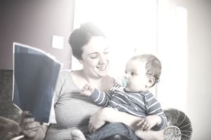 A picture of a mom holding a life insurance policy with her child