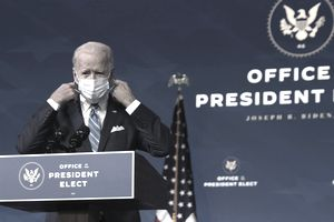 WILMINGTON, DELAWARE - JANUARY 14: U.S. President-elect Joe Biden takes off his mask as he arrives at the Queen theater to present his plan for combating the coronavirus and jump-starting the nation's economy January 14, 2021 in Wilmington, Delaware. President-elect Biden is expected to unveil a stimulus package with a price tag of trillions of dollars including a $1,400 direct payment to individuals who have been struggling with the economic turmoil caused by the COVID-19 pandemic. (Photo by Alex Wong/Getty Images)