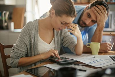 Couple looking stressed while working on finances