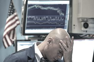 Barclays Capital trader Mario Picone holds his head during a stock market crash.
