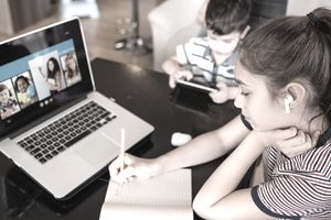 Teen girl remote learning via online video lesson