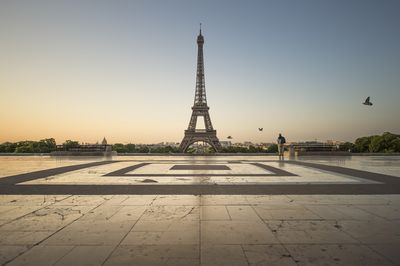 The Eiffel Tower, Paris, France at sunrise with the city in the background..