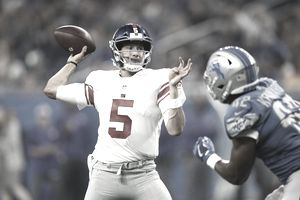 New York Giants Quarterback Davis Webb throws a first half pass behind Devon Kennard of the Detroit Lions during a pre-season game at Ford Field on August 17, 2017 in Detroit, Michigan