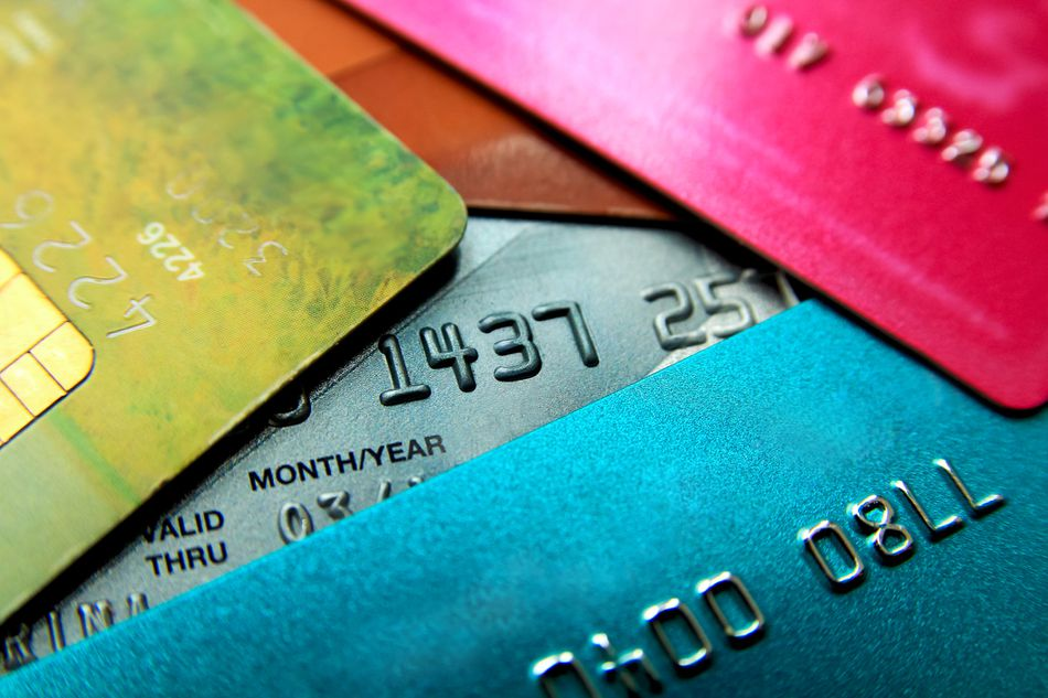 Stack of multicolored credit cards close-up view with selective focus