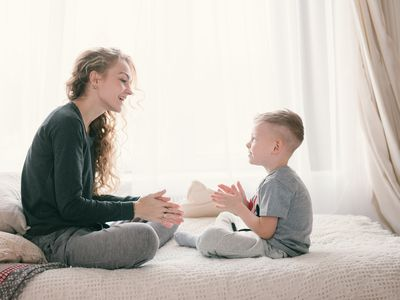 Nanny and Child Laughing and Playing on the Morning Bed