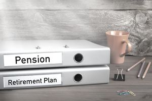 Retirement Plan and Pension - two folders on wooden office desk