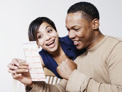 A couple looking happy after winning a lottery