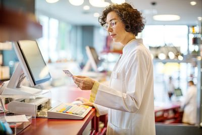 A woman looks at a credit card.
