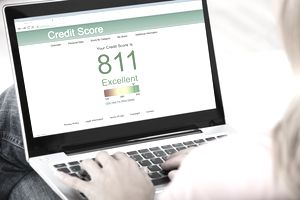 Woman Checking Credit Score Online On Laptop