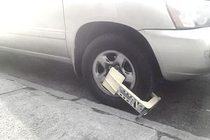 Tire boot on vehicle