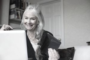 Senior woman using laptop.