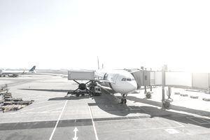 A plane waits at the gate to taxi and take off.