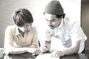 Young married couple filling out important paper documents