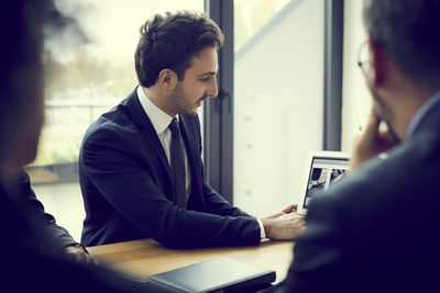 a financial adviser discusses fees with clients.