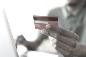 Person paying with credit card may not realize their credit utilization ratio.