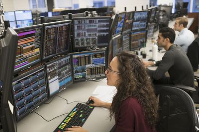 Stock Traders working at their desks.