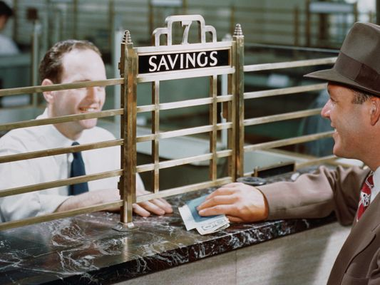 Bank teller and savings account customer