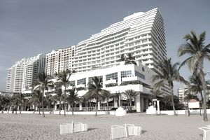 View from a beach of a high rise timeshare condo building.