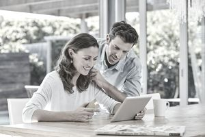 Couple making payment with credit card