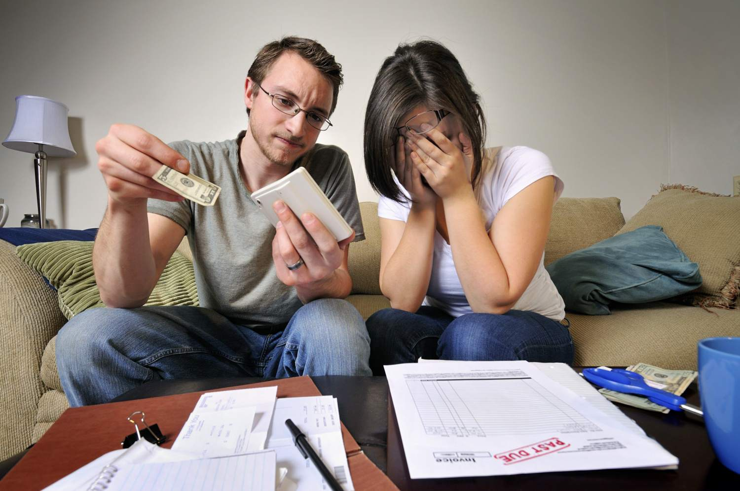 Couple looking distressed over money