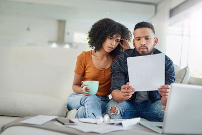Young couple checks investment statement