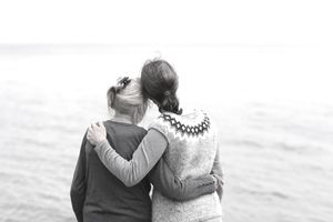 Two generations of women embracing