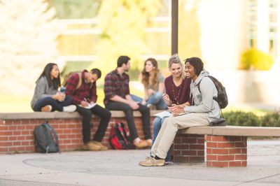 College students studying outside at center campus during lunch