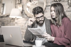 Young couple examining loan documents