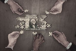 Painting of hands putting a dollar bill puzzle together