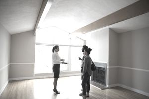 Realtor showing new house to young couple