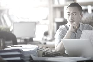 Man Doing Research at Desk