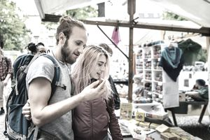 Backpacking Couple Exploring Local Market