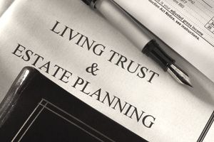 Closeup shot of living trust and estate planning documents with a fountain pen
