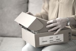 Young woman opening a package