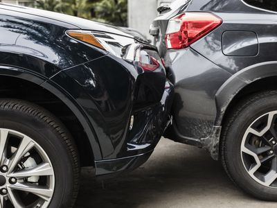 Damaged bumpers from car accident requiring a collision coverage policy