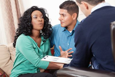 couple discussing credit with an advisor
